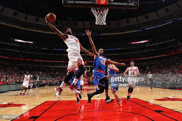 Jimmy Butler of the Chicago Bulls goes for the dunk against the New York Knicks during the game on January 1 2016 at United Center in Chicago...