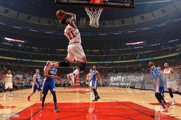Jimmy Butler of the Chicago Bulls goes for the dunk during the game against the Philadelphia 76ers on December 14 2015 at the United Center in...