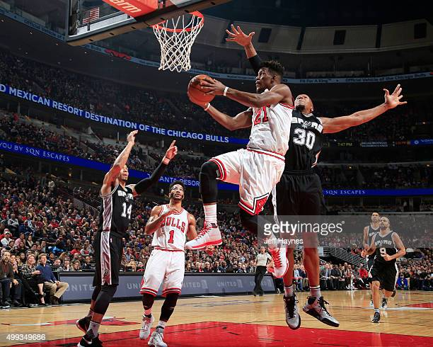 Jimmy Butler of the Chicago Bulls goes for the layup against the San Antonio Spurs during the game on November 30 2015 at United Center in Chicago...