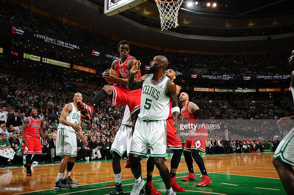 Jimmy Butler #21 of the Chicago Bulls goes to the basket against Kevin Garnett #5 of the Boston Celtics on February 13, 2013 at the TD Garden in Boston, Massachusetts.
