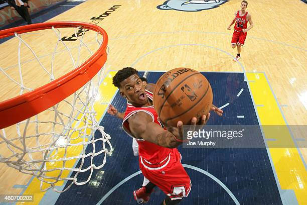 Jimmy Butler of the Chicago Bulls goes to the basket against the Memphis Grizzlies on December 19 2014 at the FedExForum in Memphis Tennessee NOTE TO...