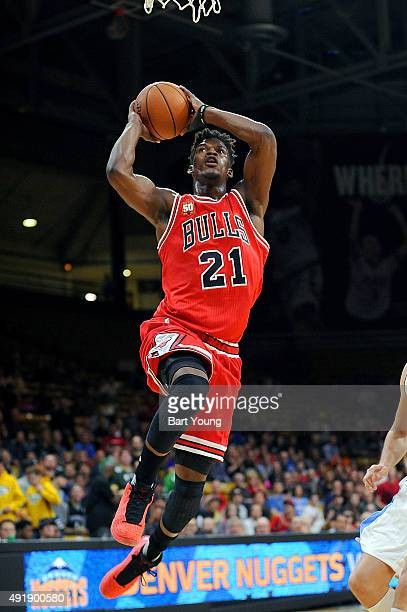 Jimmy Butler of the Chicago Bulls goes up for a dunk against the Denver Nuggets during a preseason game on October 8 2015 at the Coors Event Center...