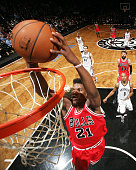 Jimmy Butler of the Chicago Bulls goes up for a dunk against the Brooklyn Nets on April 13 2015 at the Barclays Center in the Brooklyn borough of New...