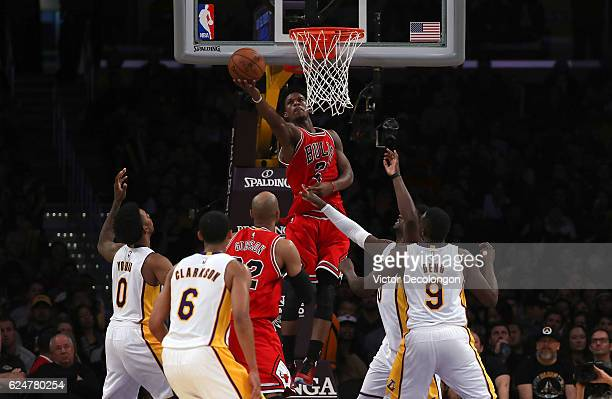 Jimmy Butler of the Chicago Bulls goes up for a layup shot from behind the backboard during the second half of the NBA game against the Los Angeles...