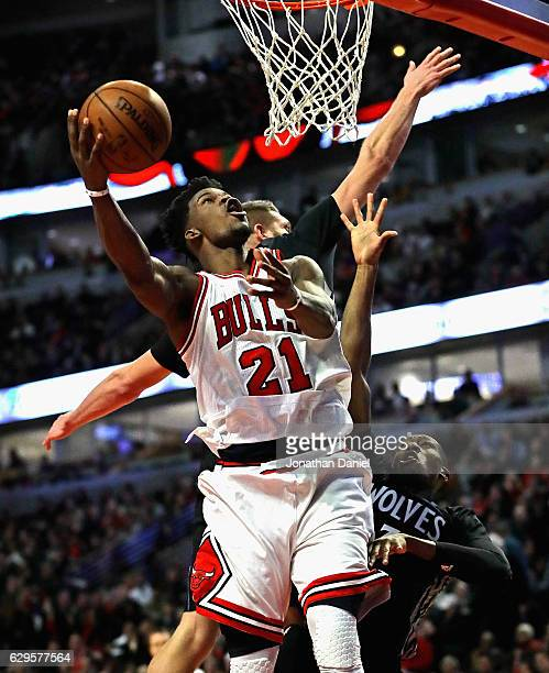 Jimmy Butler of the Chicago Bulls goes up for a shot against Cole Aldrich and Kris Dunn of the Minnesota Timberwolves on his way to a gamehigh 27...