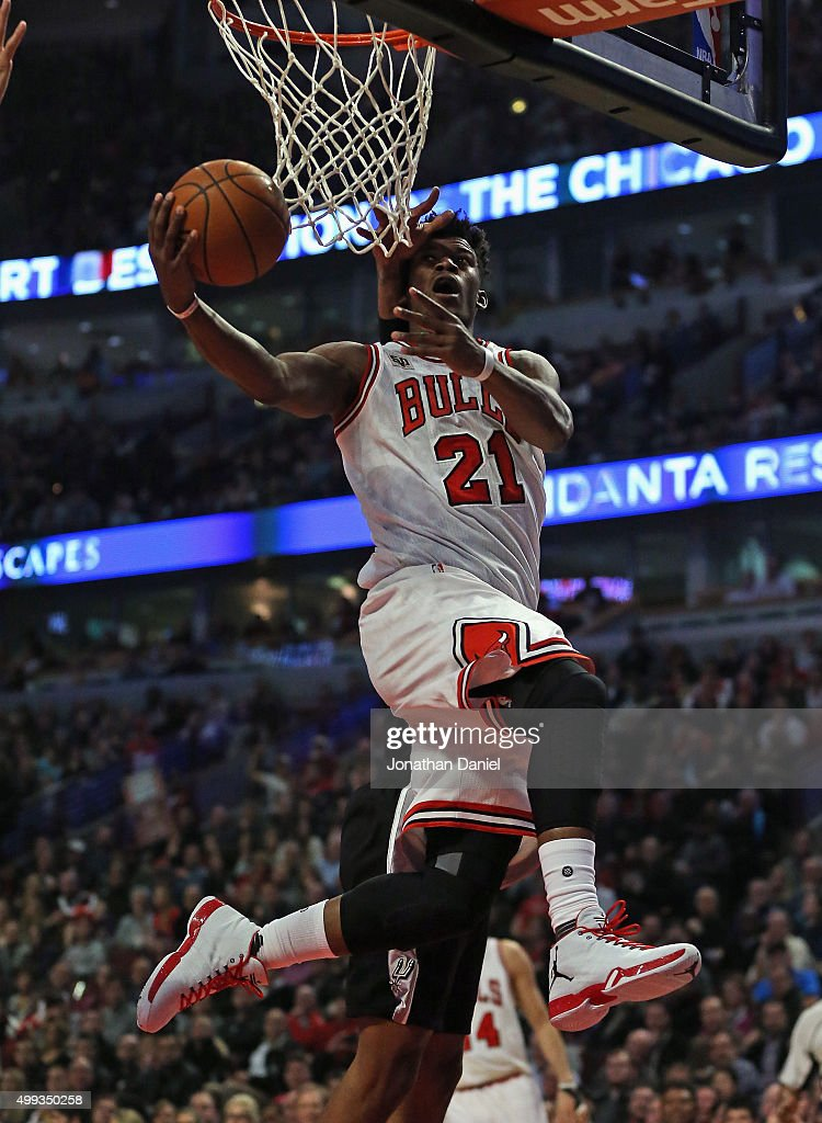 Jimmy Butler #21 of the Chicago Bulls goes up for a shot against the San Antonio Spurs at the United Center on November 30, 2015 in Chicago, Illinois. Note to User: User expressly acknowledges and agrees that, by downloading and or using the photograph, User is consenting to the terms and conditions of the Getty Images License Agreement.