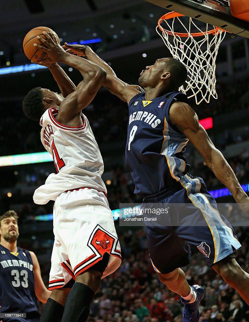 Jimmy Butler #21 of the Chicago Bulls goes up for a shot against Tony Allen #9 of the Memphis Grizzles at the United Center on January 19, 2013 in Chicago, Illinois. The Grizzlies defeated the Bulls 85-82 in overtime.