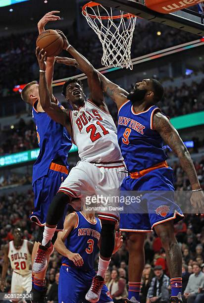 Jimmy Butler of the Chicago Bulls goes up for a shot between Kristaps Porzingis and Kyle O'Quinn of the New York Knicks on his way to a gamehigh 23...