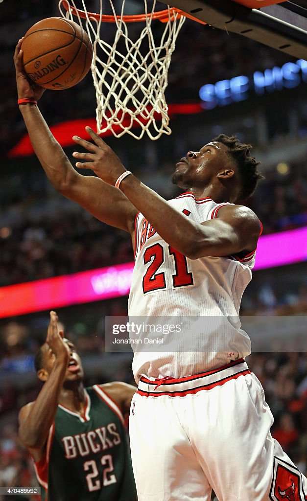 <a gi-track='captionPersonalityLinkClicked' href=/galleries/search?phrase=Jimmy+Butler+-+Basketball&family=editorial&specificpeople=9860567 ng-click='$event.stopPropagation()'>Jimmy Butler</a> #21 of the Chicago Bulls goes up for a shot over <a gi-track='captionPersonalityLinkClicked' href=/galleries/search?phrase=Khris+Middleton&family=editorial&specificpeople=6689629 ng-click='$event.stopPropagation()'>Khris Middleton</a> #22 of the Milwaukee Bucks on his way to a game-high 31 points during the first round of the 2015 NBA Playoffs at the United Center on April 20, 2015 in Chicago, Illinois. The Bulls defeated the Bucks 91-82.