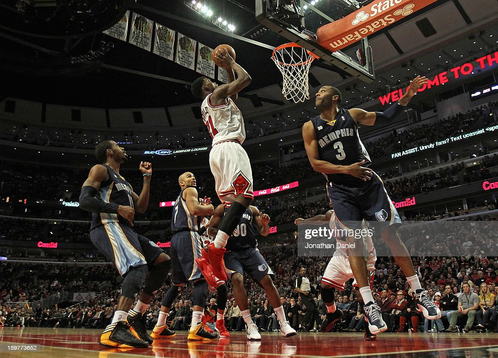 Jimmy Butler #21 of the Chicago Bulls goes up for a shot over Wayne Ellington #3 of the Memphis Grizzles at the United Center on January 19, 2013 in Chicago, Illinois. The Grizzlies defeated the Bulls 85-82 in overtime.