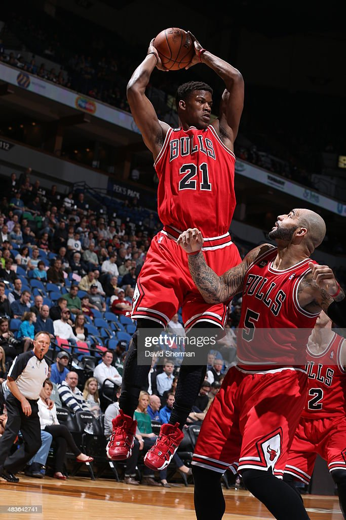 Jimmy Butler #21 of the Chicago Bulls goes up for the ball against the Minnesota Timberwolves during the game on April 9, 2014 at Target Center in Minneapolis, Minnesota.