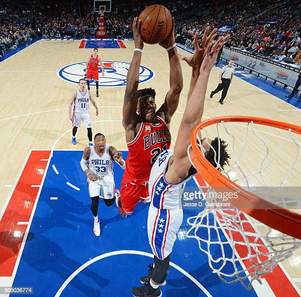 Jimmy Butler of the Chicago Bulls goes up for the dunk in traffic against the Philadelphia 76ers at Wells Fargo Center on January 14 2015 in...