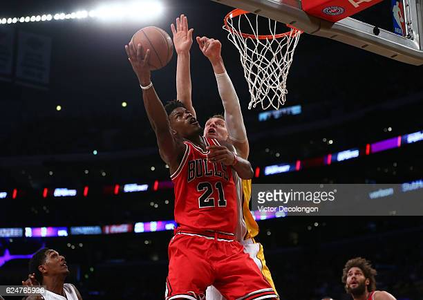 Jimmy Butler of the Chicago Bulls goes up for the layup against Timofey Mozgov of the Los Angeles Lakers during the first half of the NBA game at...