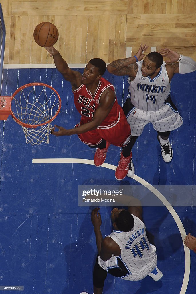 Jimmy Butler #21 of the Chicago Bulls goes up for the layup against the Orlando Magic during the game on January 15, 2014 at Amway Center in Orlando, Florida.