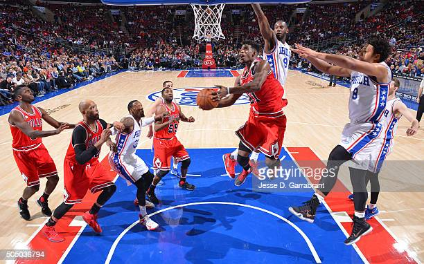 Jimmy Butler of the Chicago Bulls goes up for the layup in traffic against the Philadelphia 76ers at Wells Fargo Center on January 14 2015 in...