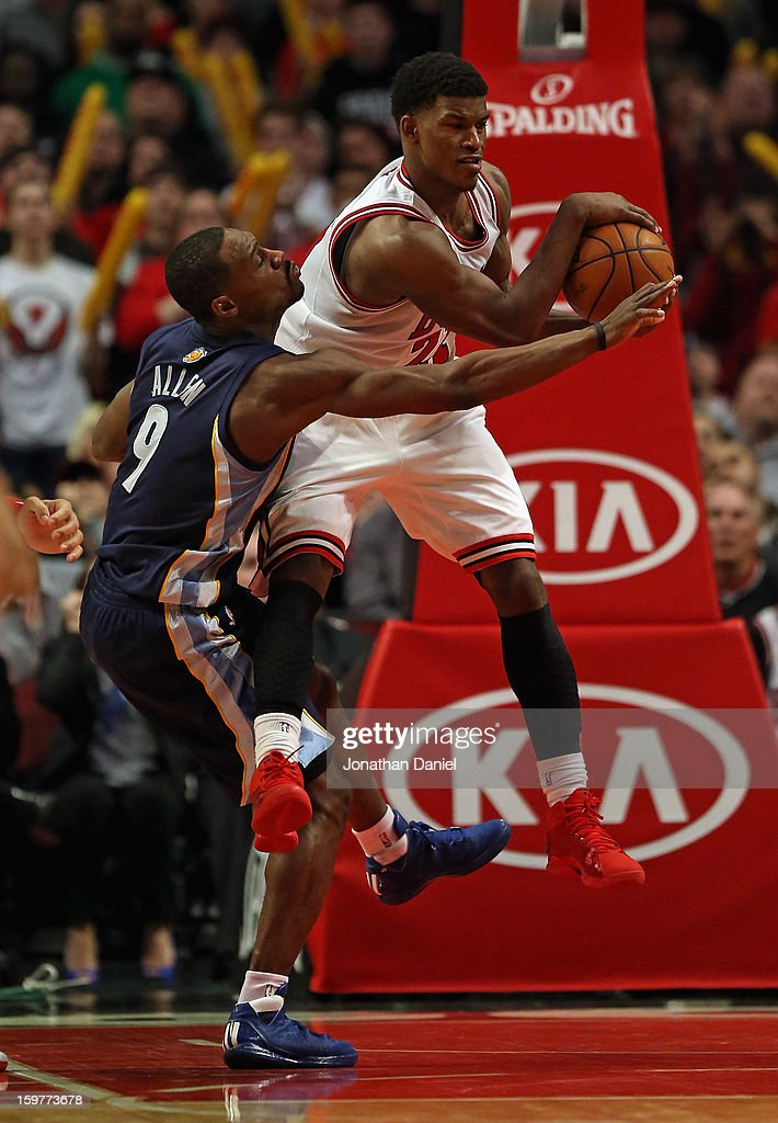 Jimmy Butler #21 of the Chicago Bulls grabs a rebound away from Tony Allen #9 of the Memphis Grizzles at the United Center on January 19, 2013 in Chicago, Illinois. The Grizzlies defeated the Bulls 85-82 in overtime.