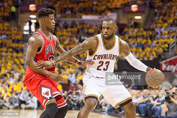 Jimmy Butler of the Chicago Bulls guards LeBron James of the Cleveland Cavaliers in the first half during Game One in the Eastern Conference...