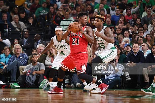 Jimmy Butler of the Chicago Bulls handles the ball against Marcus Smart of the Boston Celtics on November 2 2016 at the TD Garden in Boston...