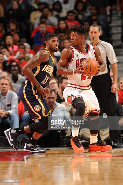 Jimmy Butler of the Chicago Bulls handles the ball against Paul George of the Indiana Pacers on October 20 2015 at the United Center in Chicago...