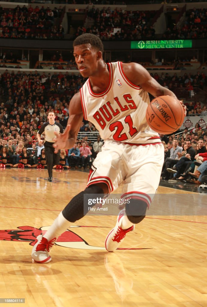 <a gi-track='captionPersonalityLinkClicked' href=/galleries/search?phrase=Jimmy+Butler+-+Jogador+de+basquetebol&family=editorial&specificpeople=9860567 ng-click='$event.stopPropagation()'>Jimmy Butler</a> #21 of the Chicago Bulls handles the ball against the Washington Wizards on December 29, 2012 at the United Center in Chicago, Illinois.