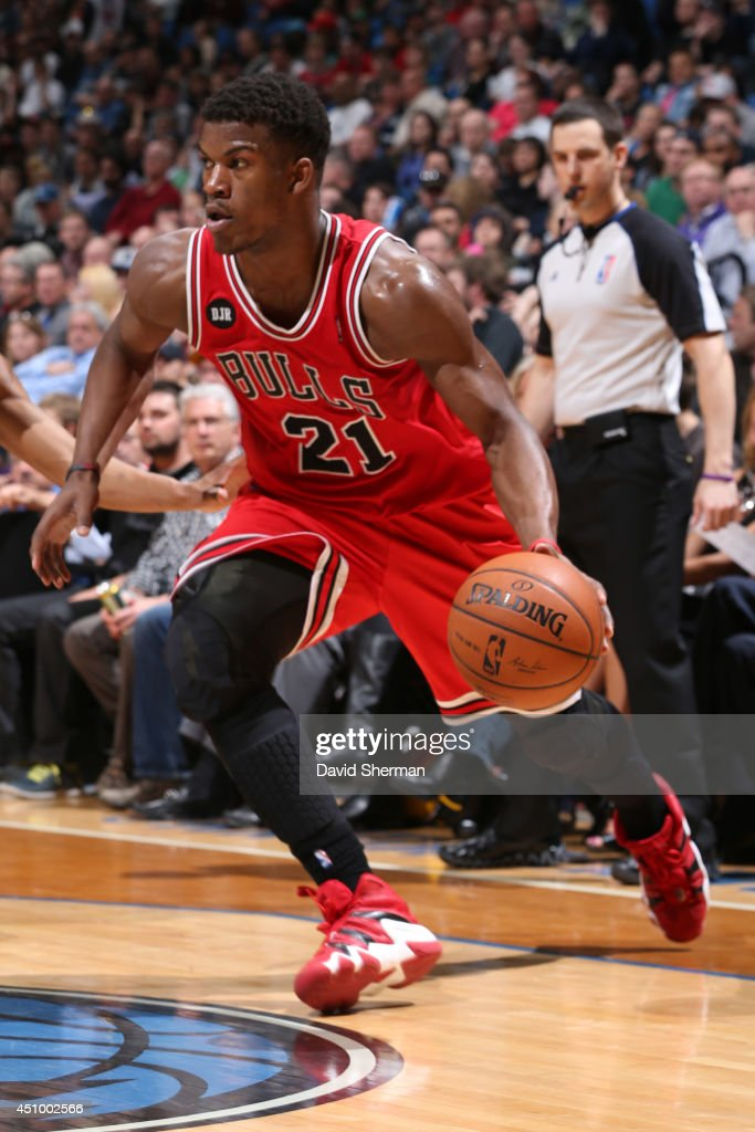Jimmy Butler #21 of the Chicago Bulls handles the ball against the Minnesota Timberwolves during the game on April 9, 2014 at Target Center in Minneapolis, Minnesota.