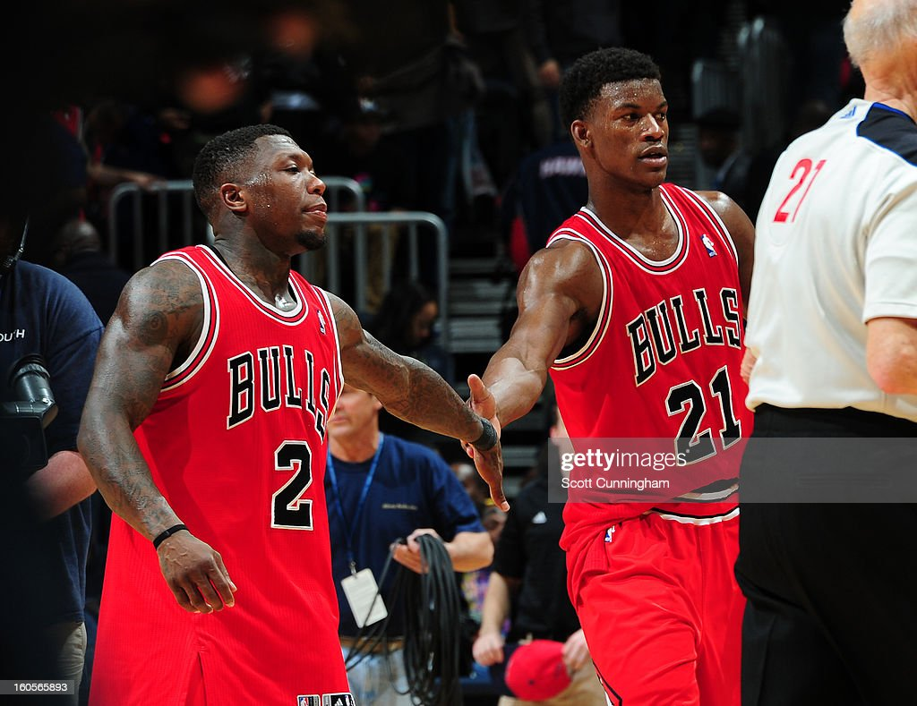 Jimmy Butler #21 of the Chicago Bulls high fives teammate Nate Robinson #2 during the game against the Atlanta Hawks on February 2, 2013 at Philips Arena in Atlanta, Georgia.