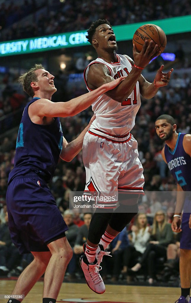 Jimmy Butler #21 of the Chicago Bulls if fouled by Cody Zeller #40 of the Charlotte Hornets at the United Center on December 5, 2015 in Chicago, Illinois. The Hornets defeated the Bulls 102-96. Note to User: User expressly acknowledges and agrees that, by downloading and or using the photograph, User is consenting to the terms and conditions of the Getty Images License Agreement.