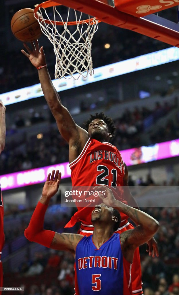Jimmy Butler #21 of the Chicago Bulls leaps over Kentavious Caldwell-Pope #5 of the Detroit Pistons to block a shot at the United Center on March 22, 2017 in Chicago, Illinois.