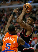 Jimmy Butler of the Chicago Bulls looks to pass over Tim Hardaway Jr #5 of the New York Knicks at the United Center on October 31 2013 in Chicago...