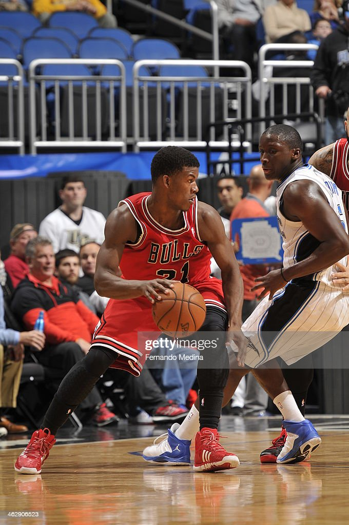 Jimmy Butler #21 of the Chicago Bulls looks to pass the ball against the Orlando Magic during the game on January 15, 2014 at Amway Center in Orlando, Florida.