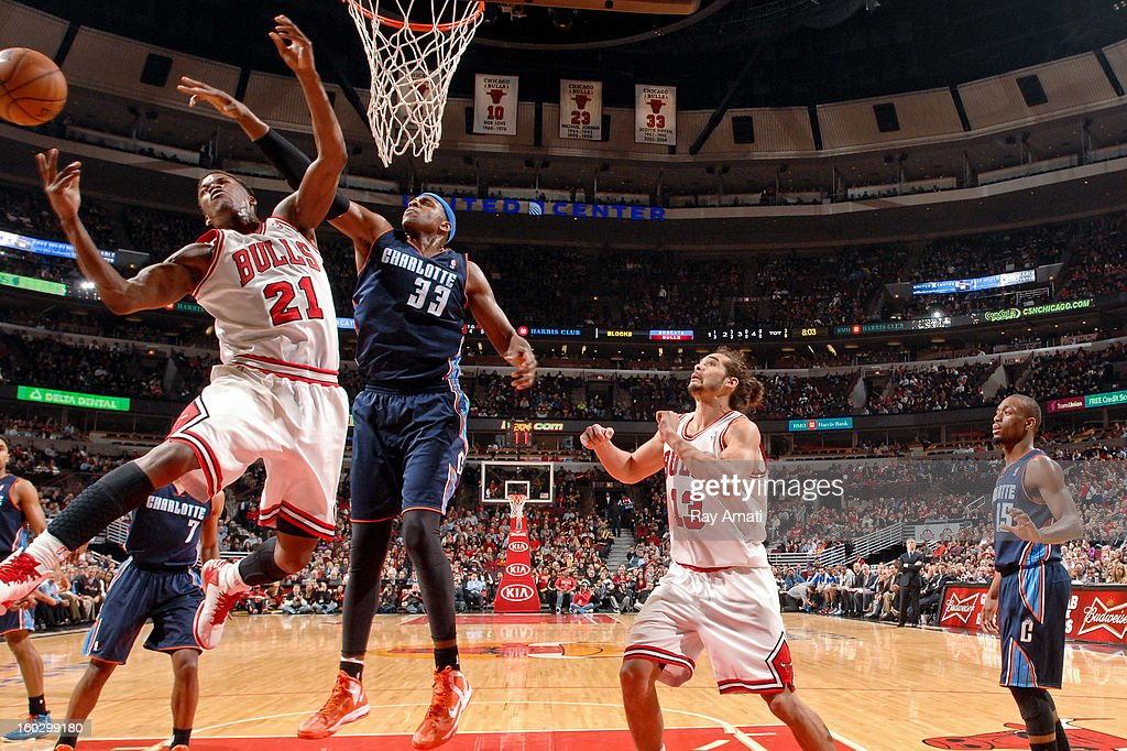 Jimmy Butler #21 of the Chicago Bulls loses control of the ball while going to the basket against Brendan Haywood #33 of the Charlotte Bobcats on January 28, 2013 at the United Center in Chicago, Illinois.