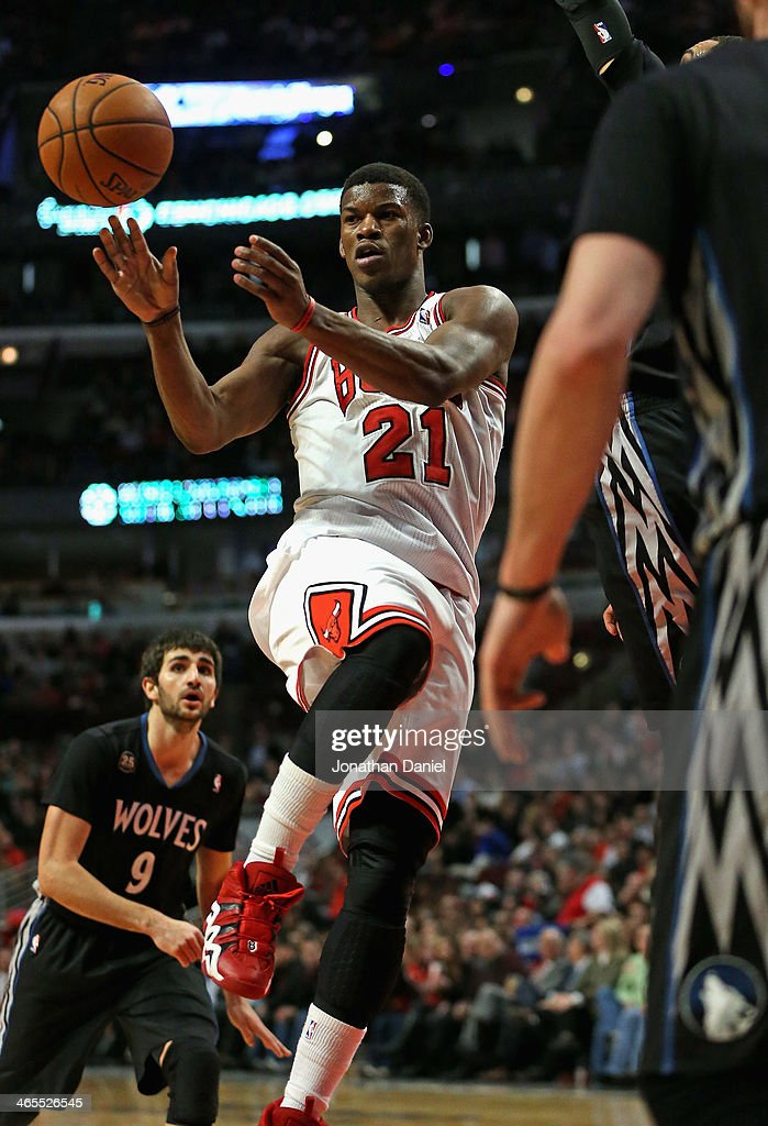 Jimmy Butler #21 of the Chicago Bulls passes against the Minnesota Timberwolves at the United Center on January 27, 2014 in Chicago, Illinois. The Timberwolves defeated the Bulls 95-86.