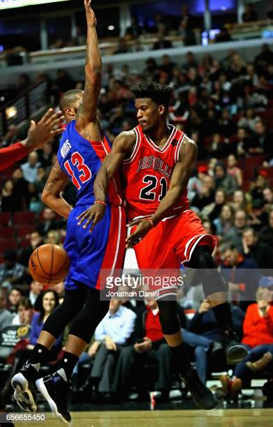 Jimmy Butler of the Chicago Bulls passes around Marcus Morris of the Detroit Pistons at the United Center on March 22 2017 in Chicago Illinois NOTE...
