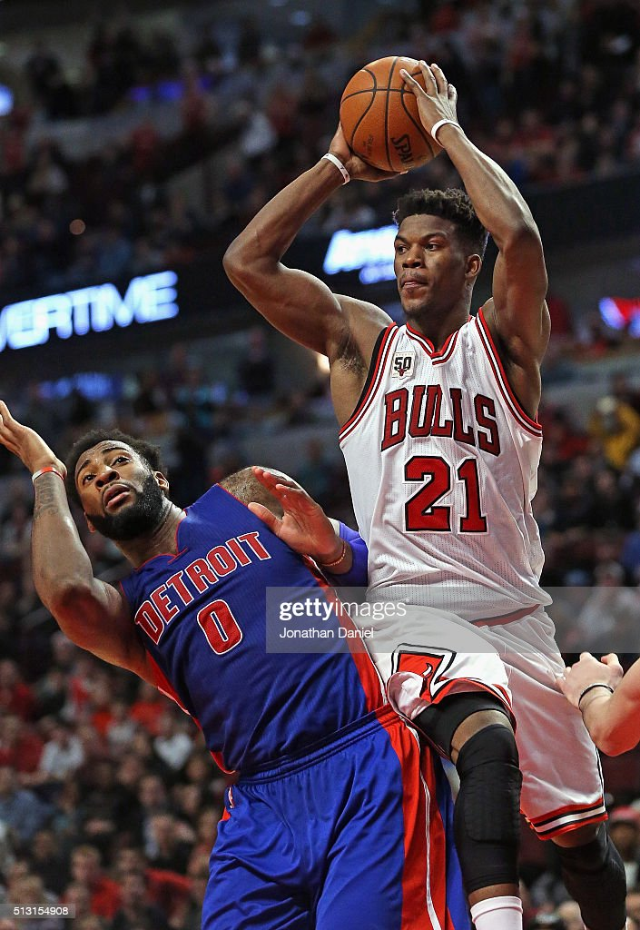 Jimmy Butler #21 of the Chicago Bulls passes over Andre Drummond #0 of the Detroit Pistons at the United Center on December 18, 2015 in Chicago, Illinois. The Pistons defeated the Bulls 147-144 in quadruple overtime.