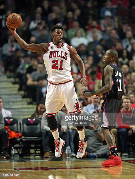 Jimmy Butler of the Chicago Bulls passes over Jamal Crawford of the Los Angeles Clippers at the United Center on December 10 2015 in Chicago Illinois...