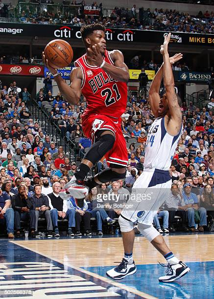 Jimmy Butler of the Chicago Bulls passes the ball during the game against the Dallas Mavericks on December 26 2015 at the American Airlines Center in...