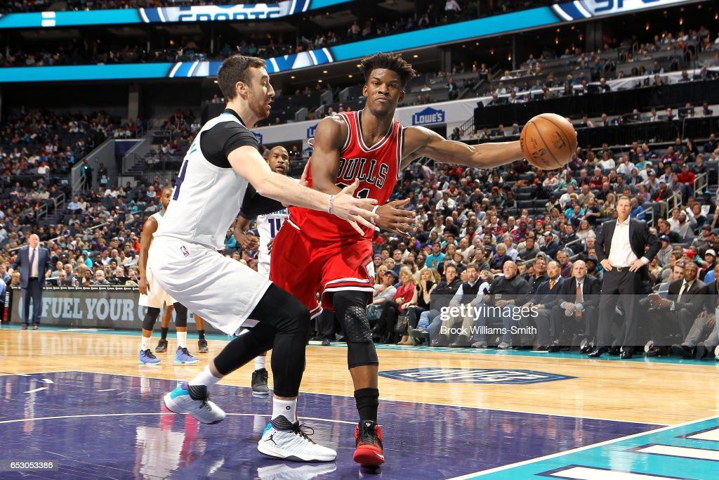 Jimmy Butler #21 of the Chicago Bulls passes the ball during the game against the Charlotte Hornets on March 13, 2017 at Time Warner Cable Arena in Charlotte, North Carolina.