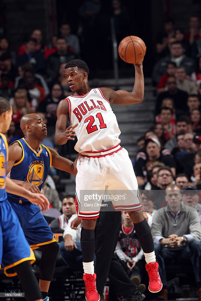 Jimmy Butler #21 of the Chicago Bulls pulls down a rebound against Jarret Jack #2 of the Golden State Warriors on January 25, 2012 at the United Center in Chicago, Illinois.