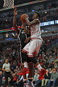 Jimmy Butler of the Chicago Bulls puts up a shot against Joe Johnson of the Brooklyn Netson his way to a gamehigh 24 points at the United Center on...