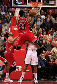 Jimmy Butler of the Chicago Bulls puts up a shot against the defense of Bradley Beal of the Washington Wizards during the second half of the Bulls...