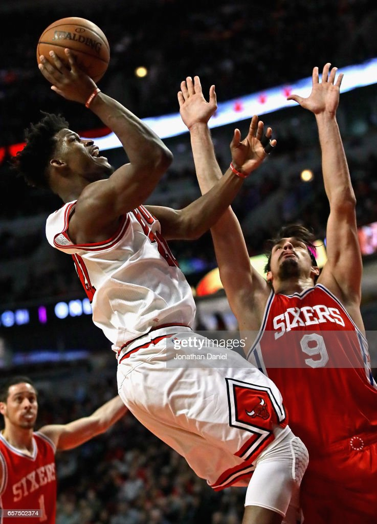 Jimmy Butler #21 of the Chicago Bulls puts up a shot over Dario Saric #9 of the Philadelphia 76ers on his way to a game-high 36 points at the United Center on March 24, 2017 in Chicago, Illinois. The 76ers defeated the Bulls 117-107.