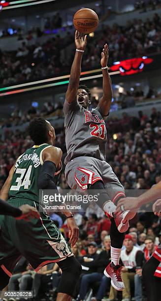 Jimmy Butler of the Chicago Bulls puts up a shot over Giannis Antetokounmpo of the Milwaukee Bucks on his way to a gamehigh 32 points at the United...