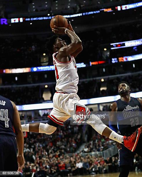 Jimmy Butler of the Chicago Bulls puts up a shot over Wesley Matthews of the Dallas Mavericks on his way to a gamehigh 21 points at the United Center...
