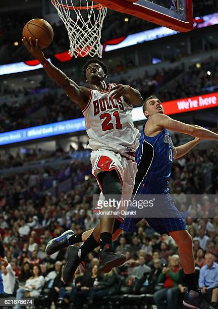 Jimmy Butler of the Chicago Bulls puts up a shot past Mario Hezonja of the Orlando Magic on his way to a gamehigh 20 points at the United Center on...