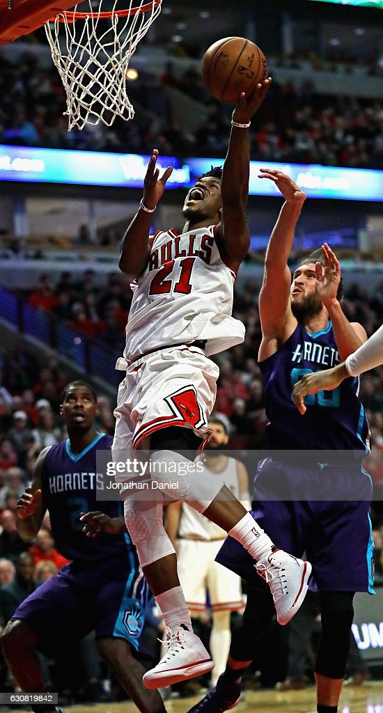 Jimmy Butler #21 of the Chicago Bulls puts up a shot past Spencer Hawes #00 of the Charlotte Hornets on his way to a game-high 52 points at the United Center on January 2, 2017 in Chicago, Illinois. The Bulls defeated the Hornets 118-111. The