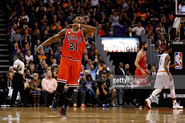 Jimmy Butler of the Chicago Bulls reacts after hitting a three point shot against the Phoenix Suns during the first half of the NBA game at Talking...