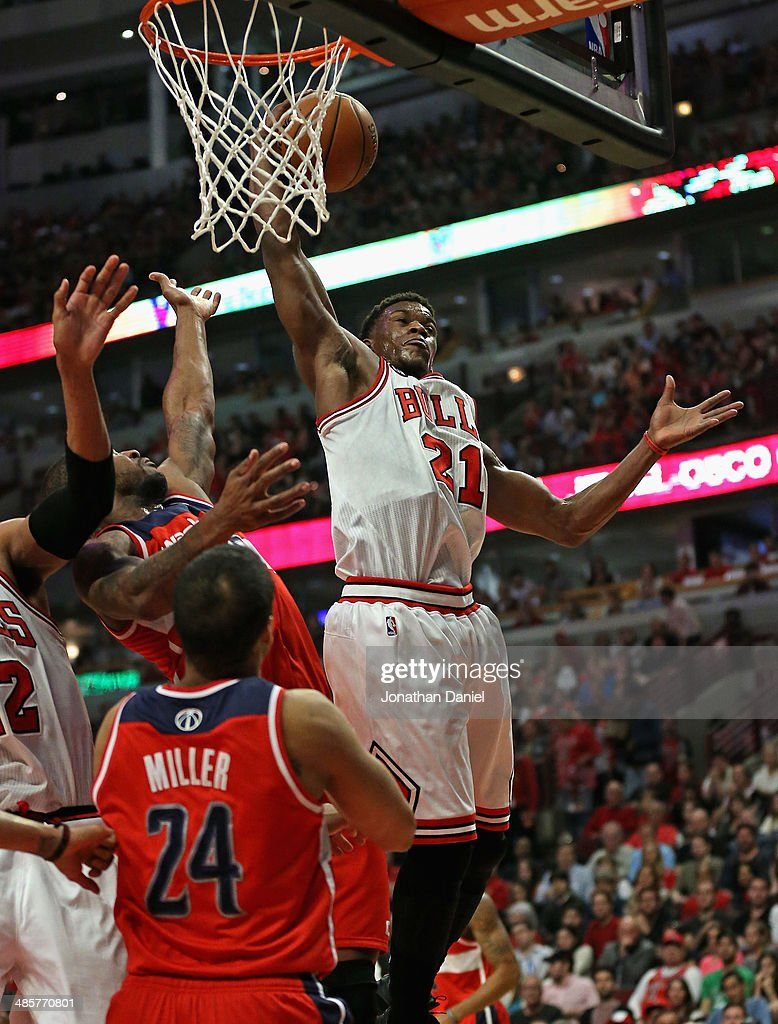 Jimmy Butler #21 of the Chicago Bulls rebounds over Trevor Booker #35 and Andre Miller #24 of the Washington Wizards in Game One of the Eastern Conference Quarterfinals during the 2014 NBA Playoffs at the United Center on April 20, 2014 in Chicago, Illinois.