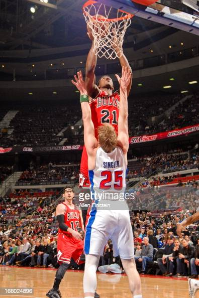Jimmy Butler of the Chicago Bulls rises for a dunk against Kyle Singler of the Detroit Pistons on April 7 2013 at The Palace of Auburn Hills in...