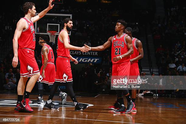 Jimmy Butler of the Chicago Bulls shakes hands with Nikola Mirotic of the Chicago Bulls against the Brooklyn Nets on October 28 2015 at Barclays...