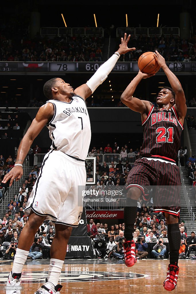 Jimmy Butler #21 of the Chicago Bulls shoots against Joe Johnson #7 of the Brooklyn Nets on April 4, 2013 at the Barclays Center in the Brooklyn borough of New York City.